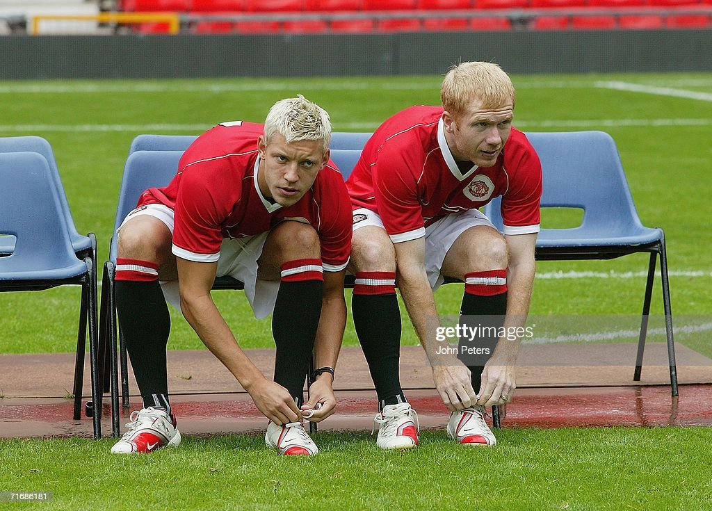 Alan Smith (L) and Paul Scholes of Manchester United takes part in the official Manchester United team photocall at Old Trafford on August 21 2006 in Manchester, England.