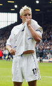 Alan Smith of Leeds celebrates kisses the badge on his shirt during the FA Barclaycard Premiership match between Leeds United and Charlton Athletic...
