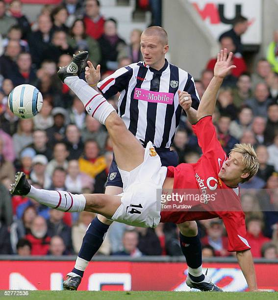 Alan Smith of Manchester United clashes with Thomas Gardsoe of West Bromwich Albion during the Barclays Premiership match between Manchester United...