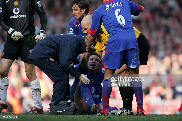 Alan Smith of Manchester United receives attention after breaking his leg during the FA Cup fifth round match between Liverpool and Manchester United...
