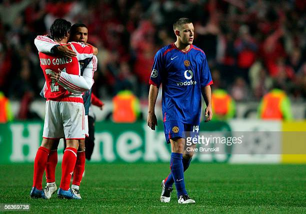 Alan Smith of Manchester United shows his dejection while Nuno Gomes of Benfica celebrates with teammate after failing to qualify for the knockout...