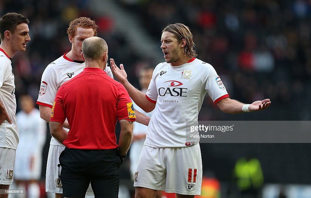 Alan Smith of Milton Keynes Dons pleads his point to Referee Andy Woolmer prior to being shown a yellow card during the npower League One match between Milton Keynes Dons and Coventry City at Stadium mk on December 29, 2012 in Milton Keynes, England.