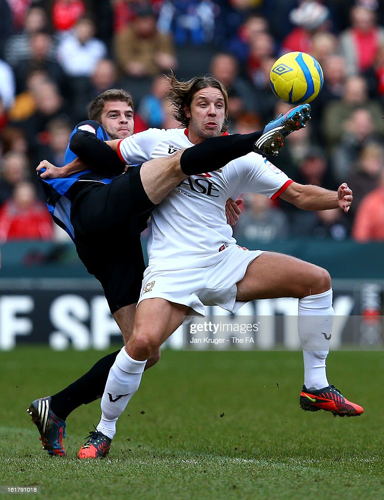 Alan Smith of MK Dons battles with <a gi-track='captionPersonalityLinkClicked' href=/galleries/search?phrase=Martin+Cranie&family=editorial&specificpeople=889729 ng-click='$event.stopPropagation()'>Martin Cranie</a> of Barnsley during the FA Cup with Budweiser Fifth Round match between MK Dons and Barnsley at StadiumMK on February 16, 2013 in Milton Keynes, England.