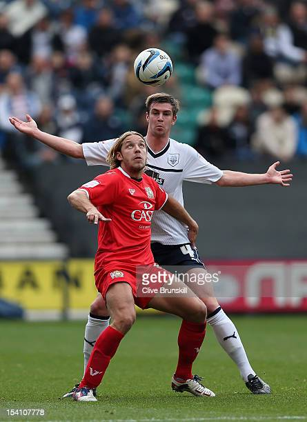 Alan Smith of MK Dons under pressure from Paul Huntington of Preston North End during the npower League One match between Preston North End and MK...