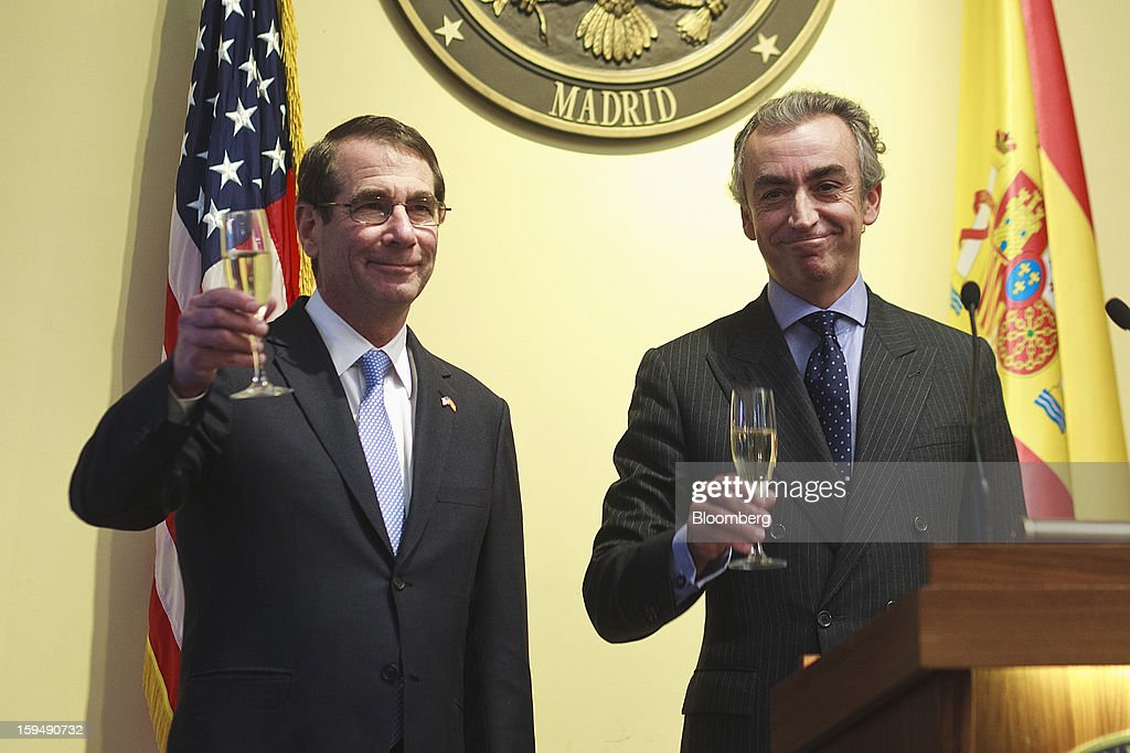 Alan Solomont, U.S. ambassador to Spain, left, and Miguel Ferre, Spain's secretary of state for the treasury, raise glasses during a news conference to mark a joint tax accord at the U.S. embassy in Madrid, Spain, on Monday, Jan. 14, 2013. European leaders declaring they've gained the upper hand in the three-year-old debt crisis are sharpening efforts to channel a rebound in financial markets to an economic recovery to chip away at soaring unemployment. Photographer: Angel Navarrete/Bloomberg via Getty Images