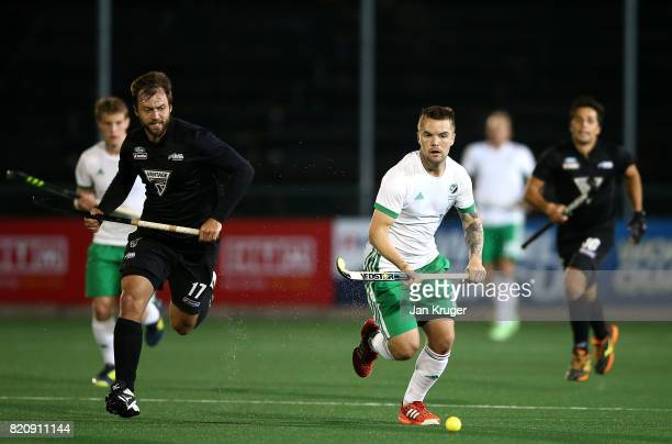 Alan Sothern of Ireland controls the ball from Nic Wood of New Zealand during day 8 of the FIH Hockey World League Men's Semi Finals 5th/ 6th place...