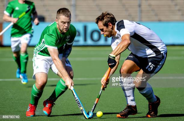 Alan Southern of Ireland in action against Florian Steyrer of Austria during the hockey semi final match between Ireland and Austria at the Rabo...