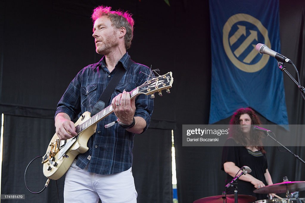 Alan Sparhawk and Mimi Parker of Low performs on stage on Day 2 of Pitchfork Music Festival 2013 at Union Park on July 20, 2013 in Chicago, Illinois.