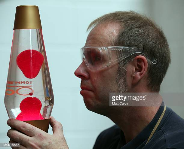 Alan Staton looks at a special 50th anniversary lava lamp at the Mathmos factory on September 12 2013 in Poole England The company based in Poole...
