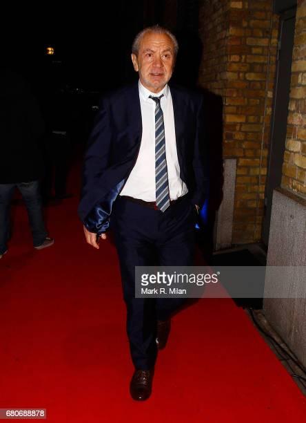 Alan Sugar departs the 60th Birthday Celebration of Richard Desmond at Old Billingsgate Market on December 8 2011 in London England