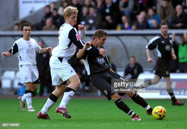 Alan Tate Swansea City and Alex Russell Bristol City battle for the ball
