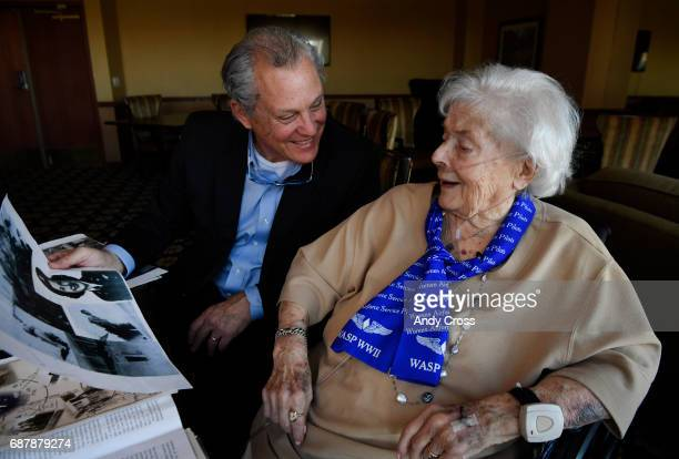Alan Tedeschi has a laugh with his mother Jane Tedeschi while going through WWII memorabilia at Brookdale Park Place senior housing community May 24...