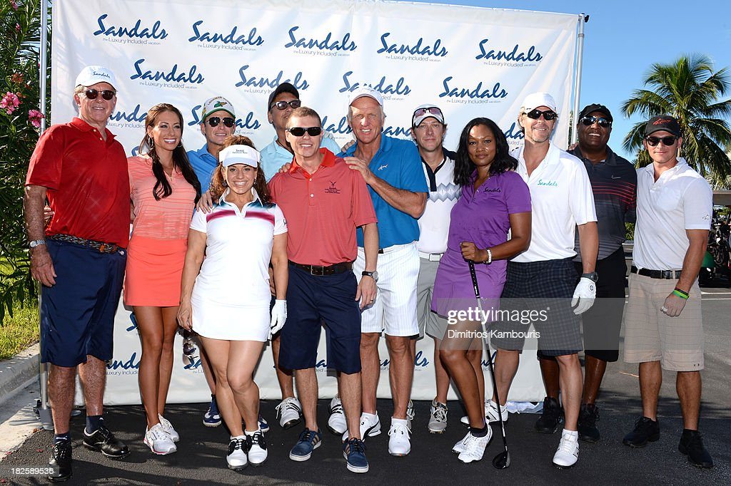 Alan Thicke, Holly Sonders, Billy Bush, Marissa Jaret Winokur, Steven Bauer, Sandals Resorts International CEO Adam Stewart, Greg Norman, Kevin Rahm, Garcelle Beauvais, Slade Smiley, Rodney Peete, and Greg Norman Jr. attend the Golf Clinic with Greg Norman and Golf Tournament during Day Three of the Sandals Emerald Bay Celebrity Getaway And Golf Weekend on September 29, 2013 at Sandals Emerald Bay in Great Exuma, Bahamas.