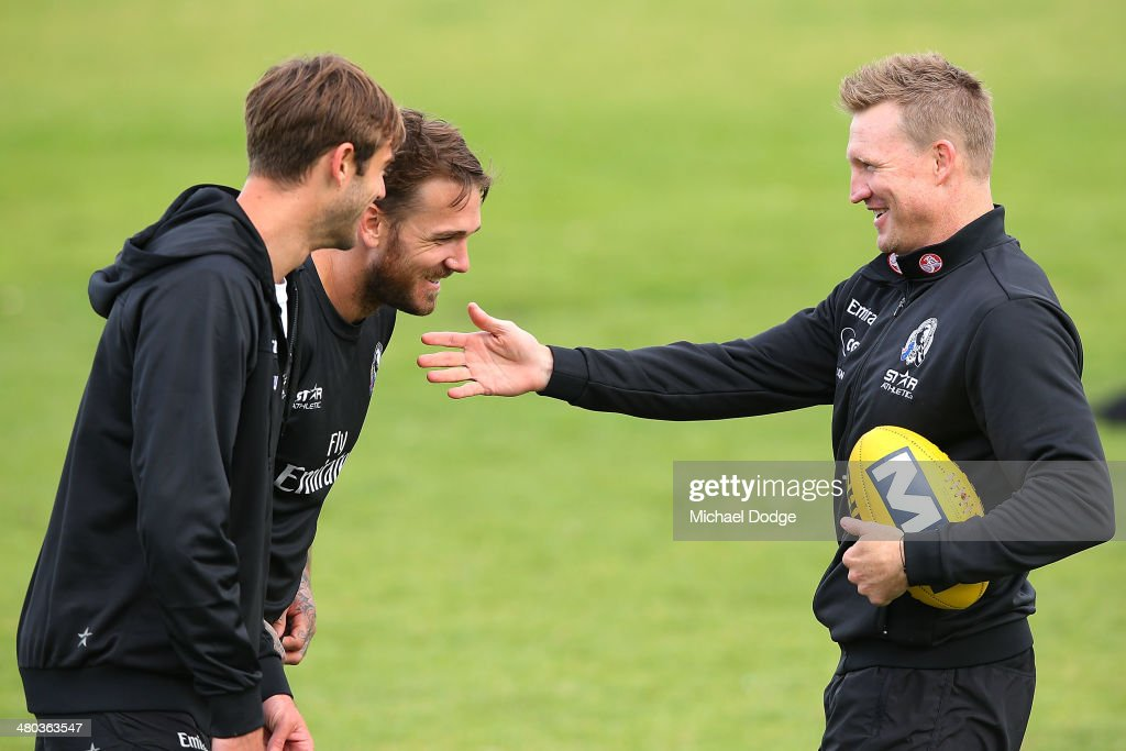 Alan Toovey Dane Swan (C) react to coach Nathan Buckley (R) during a Collingwood Magpies AFL recovery session at St Kilda Sea Baths on March 25, 2014 in Melbourne, Australia.