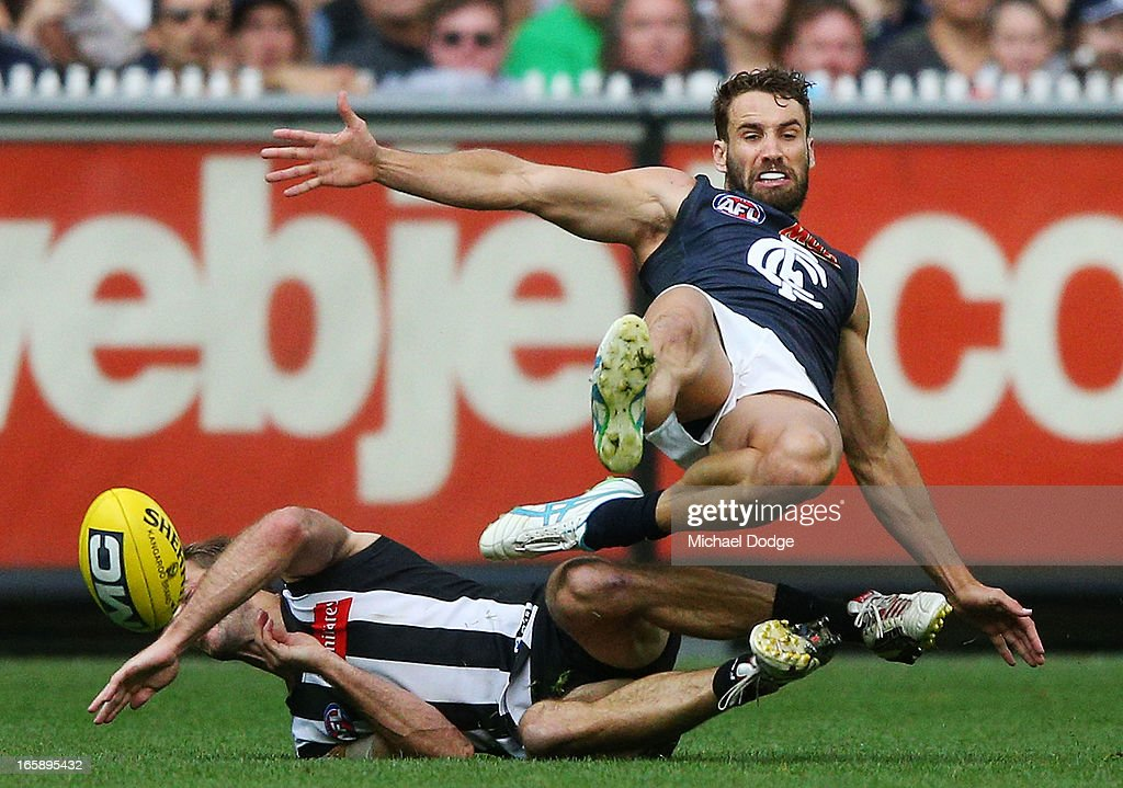 Alan Toovey (L) of the Magpies collides with Andrew Walker of the Blues during the round two AFL match between the Collingwood Magpies and the Carlton Blues at Melbourne Cricket Ground on April 7, 2013 in Melbourne, Australia.