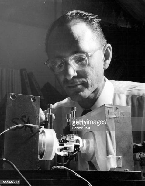 Alan White Adjusts New Miniature laser It may be used transmit thousands of messages Bell Laboratories in Van Tiny Laser Hikes By Gene Lindberg...