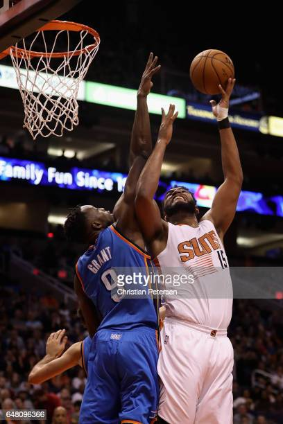 Alan Williams of the Phoenix Suns attempts a shot against Jerami Grant of the Oklahoma City Thunder during the second half of the NBA game at Talking...