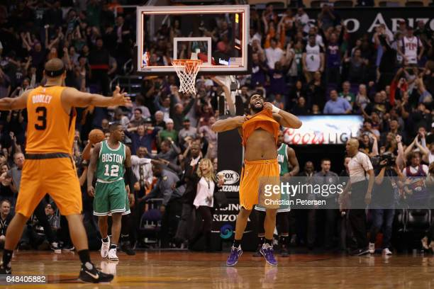Alan Williams of the Phoenix Suns celebrates after defeating the Boston Celtics in the NBA game at Talking Stick Resort Arena on March 5 2017 in...