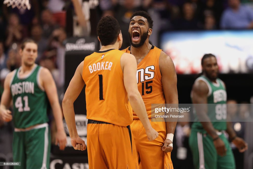 Alan Williams #15 of the Phoenix Suns celebrates with Devin Booker #1 after scoring against the Boston Celtics during the second half of the NBA game at Talking Stick Resort Arena on March 5, 2017 in Phoenix, Arizona. The Suns defeated the Celtics 109-106.