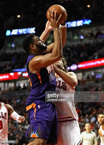 Alan Williams of the Phoenix Suns goes up against Robin Lopez of the Chicago Bulls at the United Center on February 24 2017 in Chicago Illinois The...