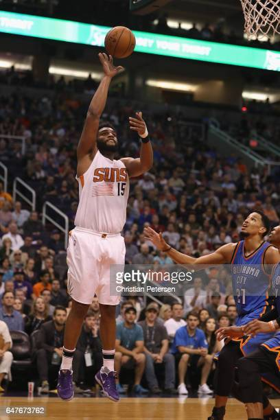 Alan Williams of the Phoenix Suns puts up a shot against the Oklahoma City Thunder during the second half of the NBA game at Talking Stick Resort...