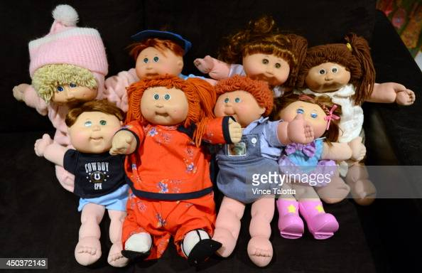 Alana and her husband David Silber with their children surround themselves with Cabbage Patch dolls and Barbie dolls that Alana has been collecting...