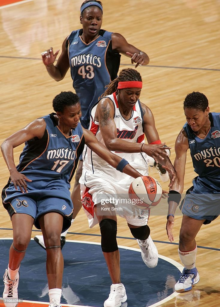 Alana Beard and Crystal Robinson of the Washington Mystics take the ball away from Sheri Sam of the Charlotte Sting on May 25 2006 at the Charlotte...