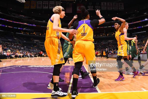 Alana Beard and Odyssey Sims of the Los Angeles Sparks high five during the game against the Seattle Storm on May 13 2017 at STAPLES Center in Los...