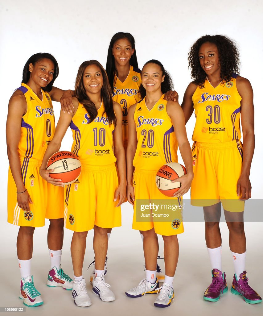 Alana Beard #0, Lindsey Harding #10, Candace Parker #3, Kristi Toliver #20, and Nneka Ogwumike #30 of the Los Angeles Sparks poses for a headshot during the Los Angeles Sparks Media Day on May 17, 2013 at St. Mary's School in Inglewood, California.