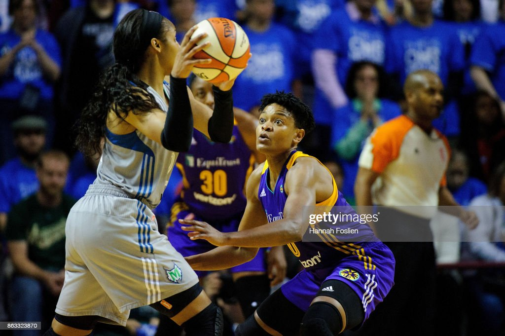Alana Beard #0 of the Los Angeles Sparks defends against Maya Moore #23 of the Minnesota Lynx during the fourth quarter of Game Two of the WNBA Finals on September 26, 2017 at Williams in Minneapolis, Minnesota. The Lynx defeated the Sparks 70-68.