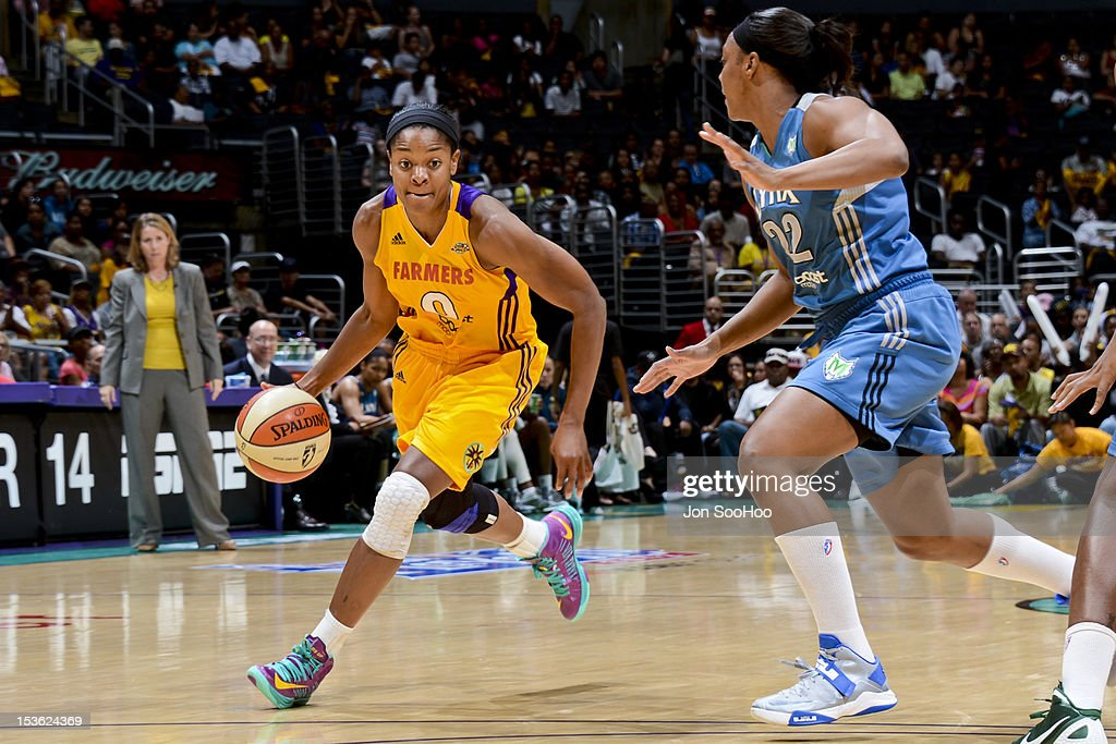 <a gi-track='captionPersonalityLinkClicked' href=/galleries/search?phrase=Alana+Beard&family=editorial&specificpeople=210691 ng-click='$event.stopPropagation()'>Alana Beard</a> #0 of the Los Angeles Sparks drives to the basket against Monica Wright #22 of the Minnesota Lynx during Game Two of the WNBA Western Conference Finals at Staples Center on October 7, 2012 in Los Angeles, California.