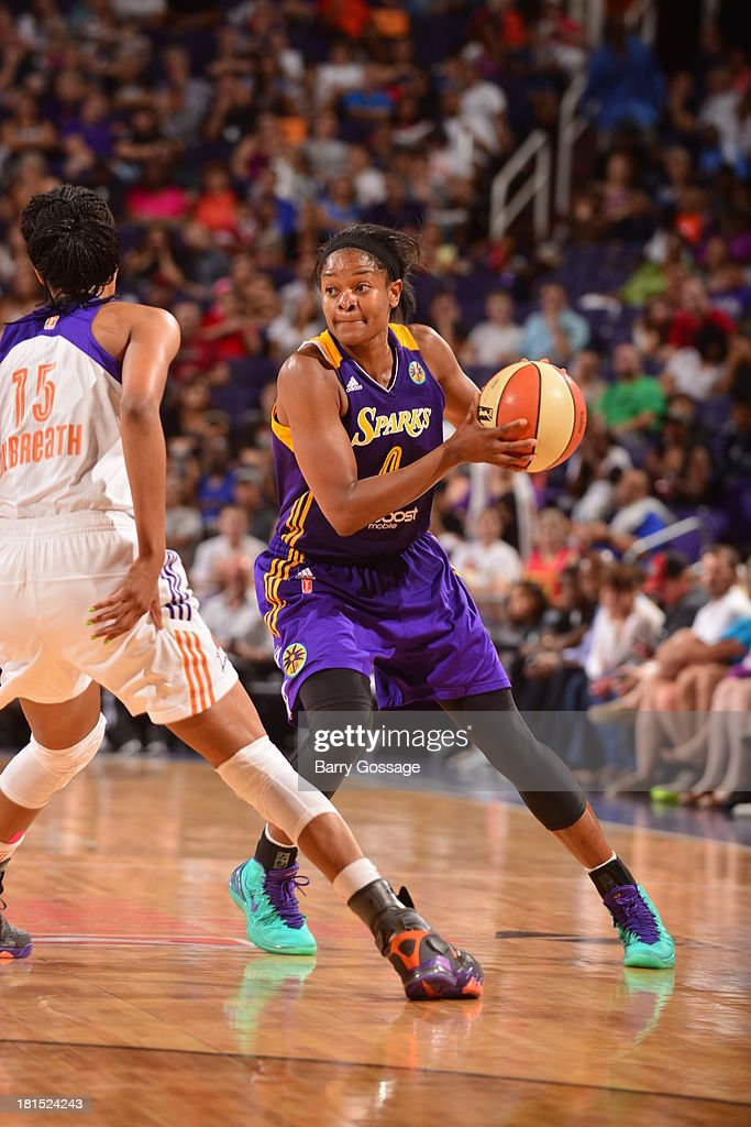 <a gi-track='captionPersonalityLinkClicked' href=/galleries/search?phrase=Alana+Beard&family=editorial&specificpeople=210691 ng-click='$event.stopPropagation()'>Alana Beard</a> #0 of the Los Angeles Sparks looks to pass against Briana Gilbreath #15 of the Phoenix Mercury in Game 2 Round 1 of the 2013 WNBA Playoffs on September 13, 2013 at U.S. Airways Center in Phoenix, Arizona.