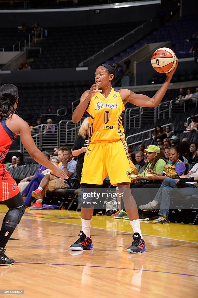 <a gi-track='captionPersonalityLinkClicked' href=/galleries/search?phrase=Alana+Beard&family=editorial&specificpeople=210691 ng-click='$event.stopPropagation()'>Alana Beard</a> #0 of the Los Angeles Sparks looks to pass the ball against the Washington Mystics at STAPLES Center on July 17, 2014 in Los Angeles, California.