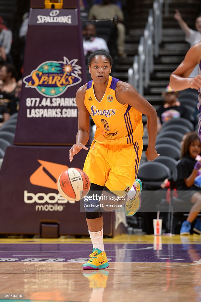 Alana Beard #0 of the Los Angeles Sparks moves the ball up-court against the Phoenix Mercury at STAPLES Center on July 24, 2014 in Los Angeles, California.