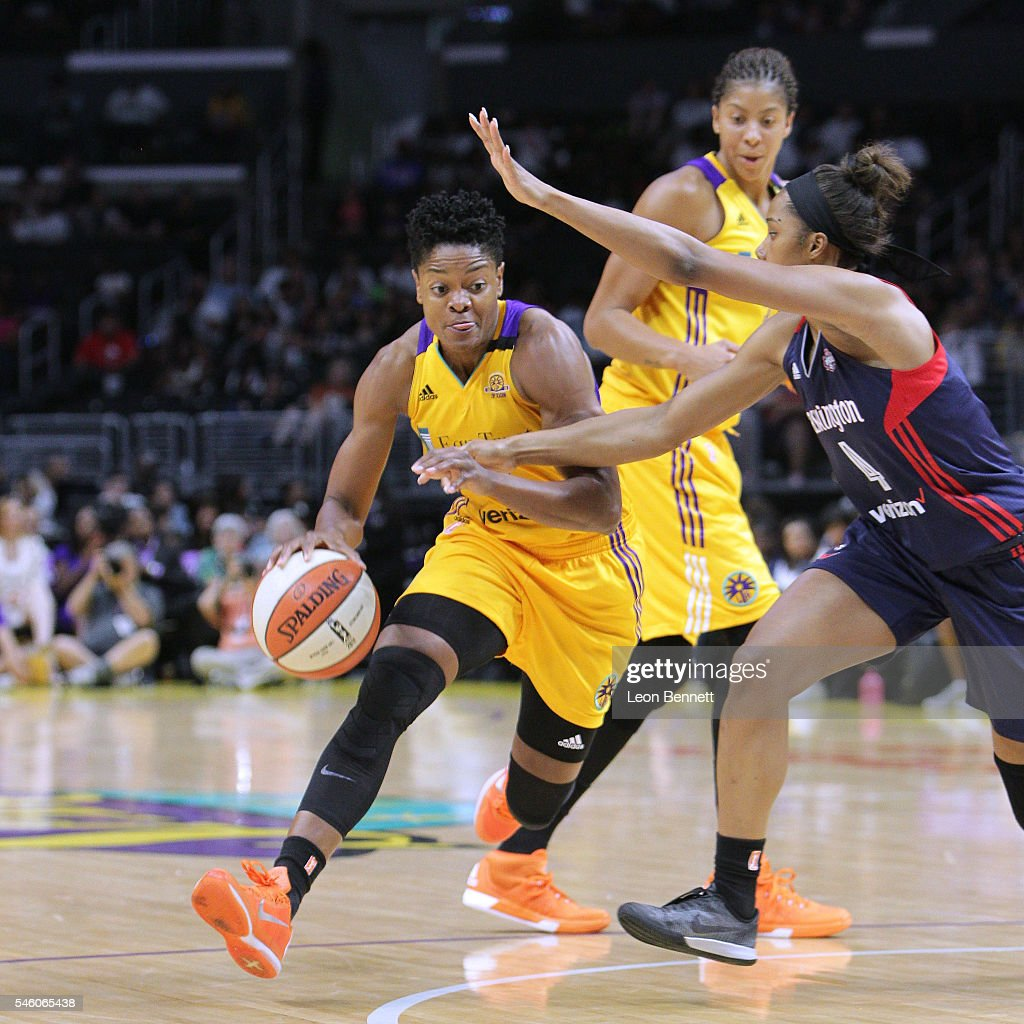 Alana Beard of the Los Sparks handles the ball against Tayler Hill of the Washington Mystics during WNBA basketball game at Staples Center on July 10...