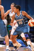 Alana Beard of the Washington Mystics avoids Anna DeForge of the Minnesota Lynx on August 30 2008 at the Target Center in Minneapolis Minnesota NOTE...