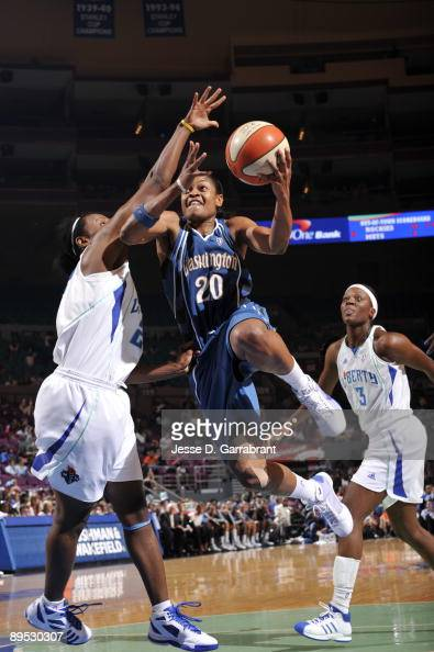 Alana Beard of the Washington Mystics goes up for a shot against Ashley Battle of the New York Liberty on July 30 2009 at Madison Square Garden in...