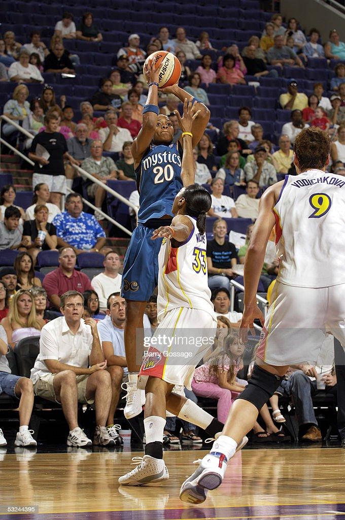 Alana Beard of the Washington Mystics shoots against Angelina Williams of the Phoenix Mercury July 15 2005 at America West Arena in Phoenix Arizona...