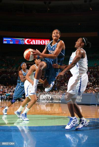 Alana Beard of the Washington Mystics shoots against Ashley Battle of the New York Liberty on July 30 2009 at Madison Square Garden in New York City...