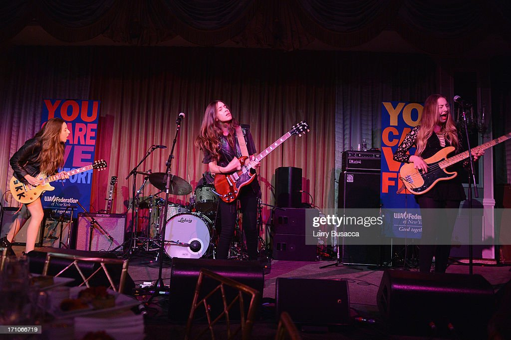 Alana, Danielle and Este Haim perform onstage at a luncheon honoring Rob Stringer as UJA-Federation of New York Music Visionary of 2013 at The Pierre Hotel on June 21, 2013 in New York City.