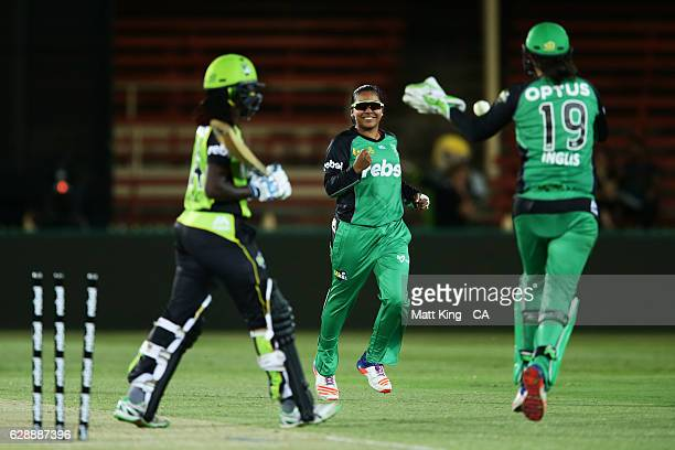 'SYDNEY AUSTRALIA DECEMBER 10 Alana King of the Stars celebrates with team mates after taking the wicket of Stafanie Taylor of the Thunder during the...