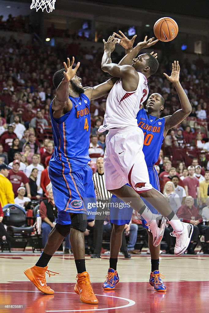 Alandise Harris #2 of the Arkansas Razorbacks has his shot blocked by <a gi-track='captionPersonalityLinkClicked' href=/galleries/search?phrase=Patric+Young&family=editorial&specificpeople=7405616 ng-click='$event.stopPropagation()'>Patric Young</a> #4 of the Florida Gators at Bud Walton Arena on January 11, 2014 in Fayetteville, Arkansas. The Gators defeated the Razorbacks 84-82.