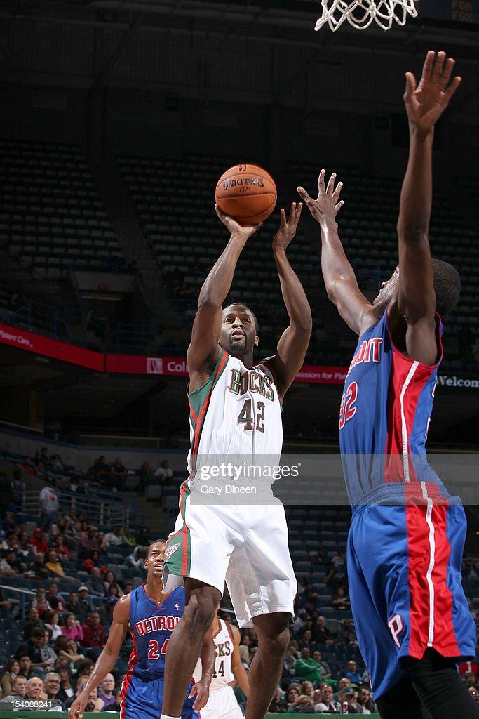 Alando Tucker #42 of the Milwaukee Bucks shoots against Khris Middleton #32 of the Detroit Pistons during the NBA preseason game on October 13, 2012 at the BMO Harris Bradley Center in Milwaukee, Wisconsin.