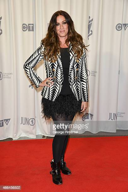 Alanis Morissette poses backstage in the press room at the 2015 Juno Awards at FirstOntario Centre on March 15 2015 in Hamilton Canada
