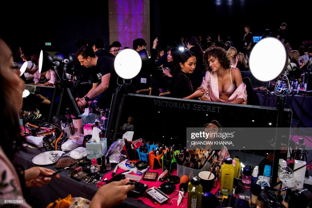 Alanna Arrington (centre R) is pictured backstage before the start of the 2017 Victoria's Secret Fashion Show in Shanghai on November 20, 2017. / AFP PHOTO / Chandan KHANNA / RESTRICTED TO EDITORIAL USE / The erroneous mention[s] appearing in the metadata of this photo has been modified in AFP systems in the following manner: [byline: Chandan KHANNA] instead of [Fred DUFOUR]. Please immediately remove the erroneous mention[s] from all your online services and delete it (them) from your servers. If you have been authorized by AFP to distribute it (them) to third parties, please ensure that the same actions are carried out by them. Failure to promptly comply with these instructions will entail liability on your part for any continued or post notification usage. Therefore we thank you very much for all your attention and prompt action. We are sorry for the inconvenience this notification may cause and remain at your disposal for any further information you may require.