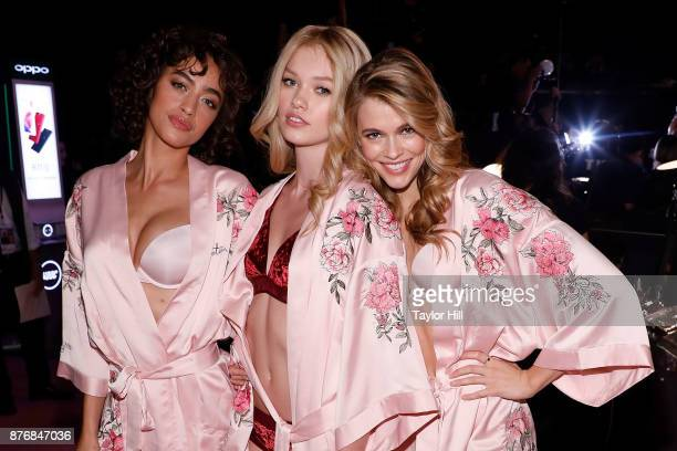 Alanna Arrington Maggie Laine and Victoria Lee pose in hairandmakeup before the Victoria's Secret Fashion Show on November 20 2017 in Shanghai China