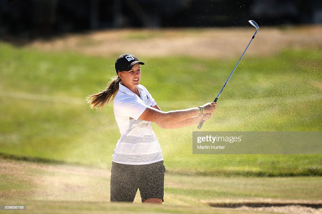 Alanna Campbell of New Zealand plays a bunker shot on the 18th hole during the 1st round of the New Zealand Women's Open at Clearwater Golf Club on February 12, 2016 in Christchurch, New Zealand.