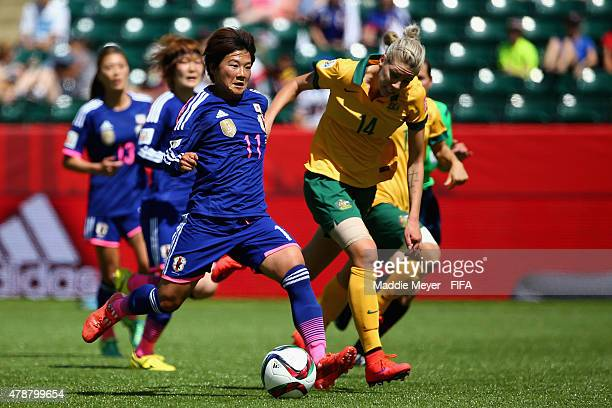 Alanna Kennedy of Australia defends Shinobu Ohno of Japan during the FIFA Women's World Cup Canada 2015 quarter final match between Japan and...