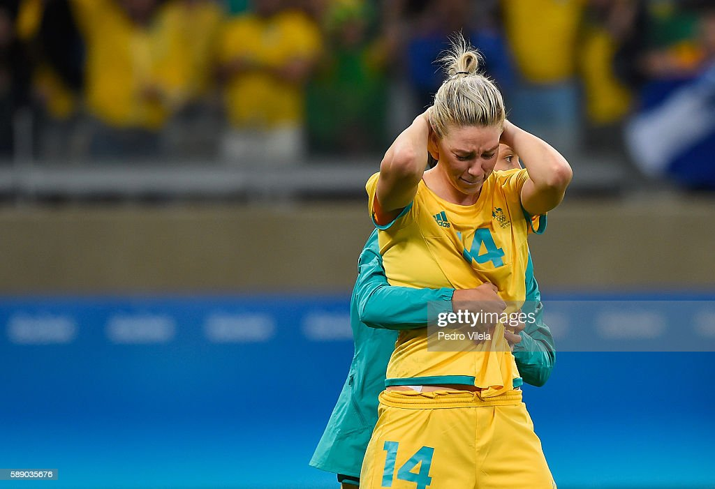 Alanna Kennedy of Australia is embraced after their 00 loss to Brazil during the Women's Football Quarterfinal match at Mineirao Stadium on Day 7 of...