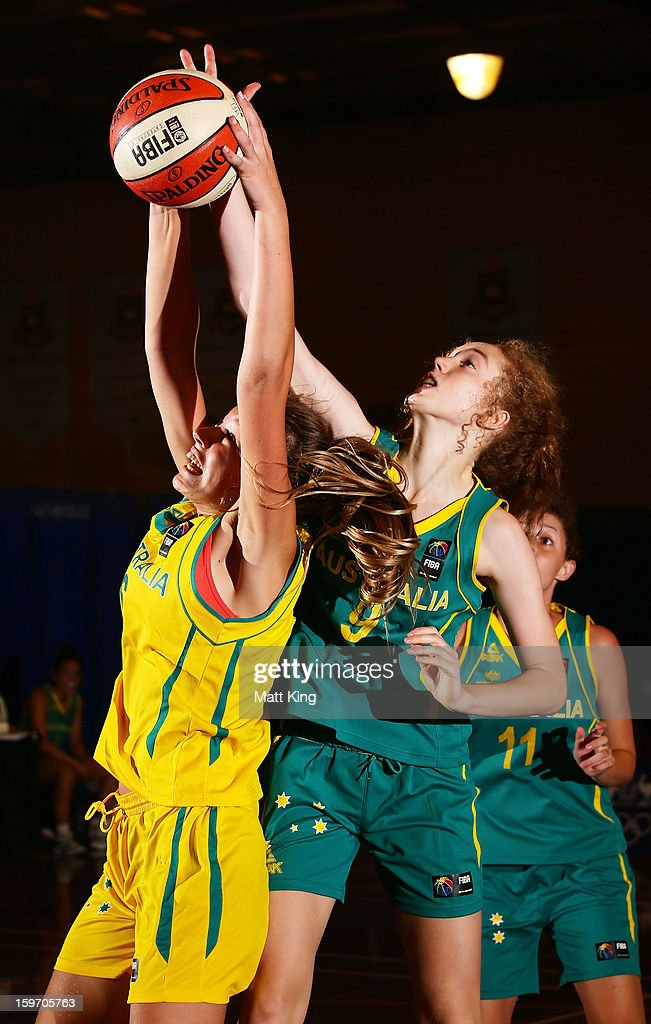 Alanna Smith of Australia Gold competes with Kate Hewett of Australia Green in the Women's gold medal playoff during day four of the Australian Youth Olympic Festival at Sydney Boys High School on January 19, 2013 in Sydney, Australia.